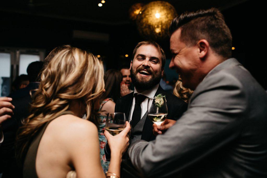 Groom laughing, Nine Fine Foods wedding
