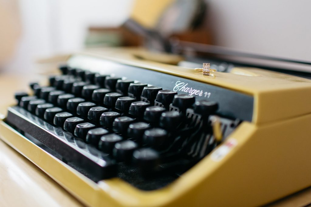 Wedding ring on vintage typewriter