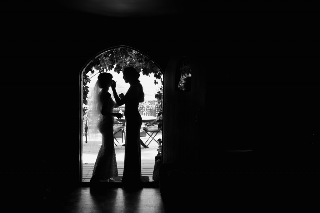 Silhouette of bride getting ready, Maison d'Évelyne