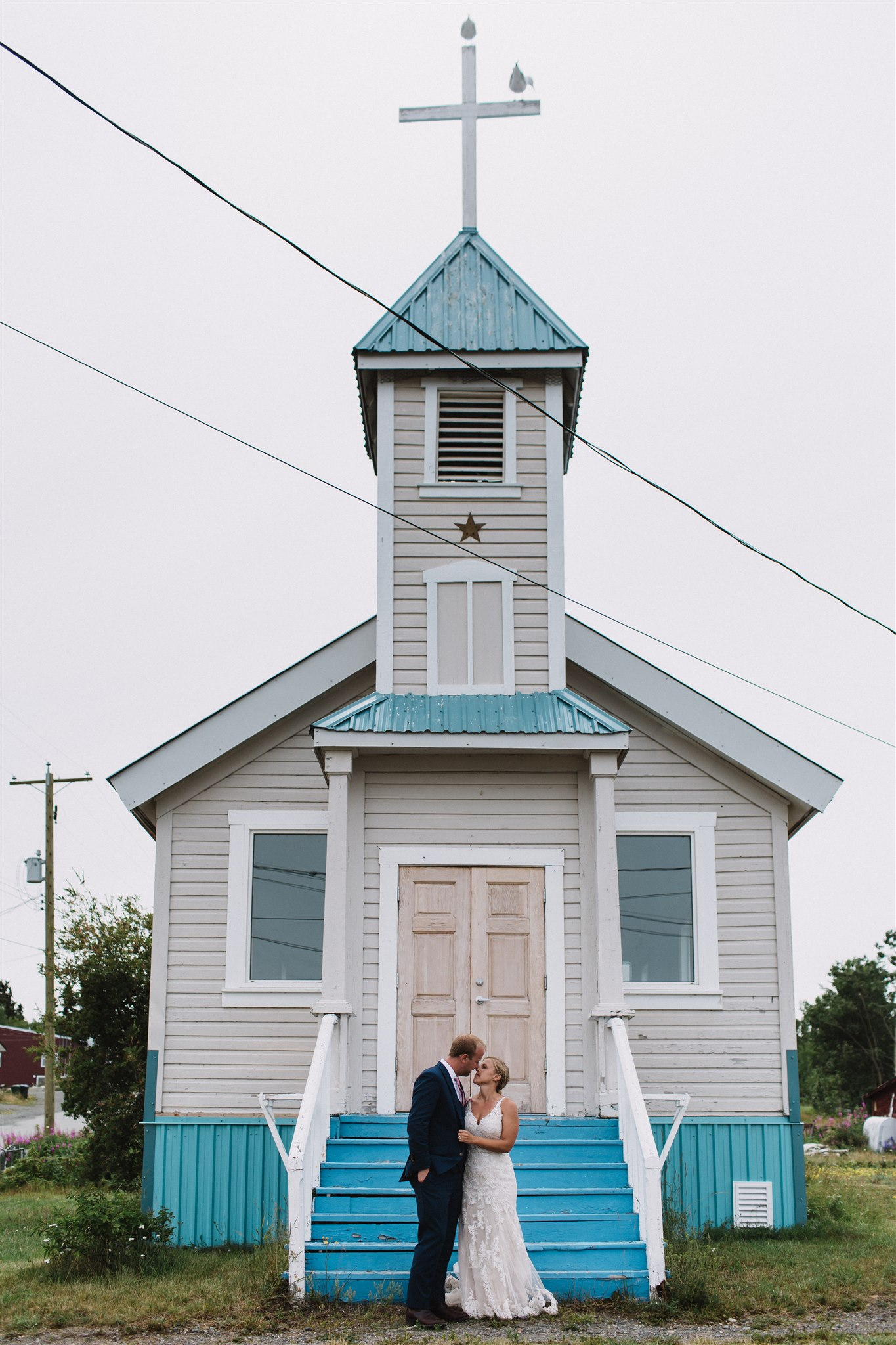 wedding photography in front of quaint church in Atlin, BC