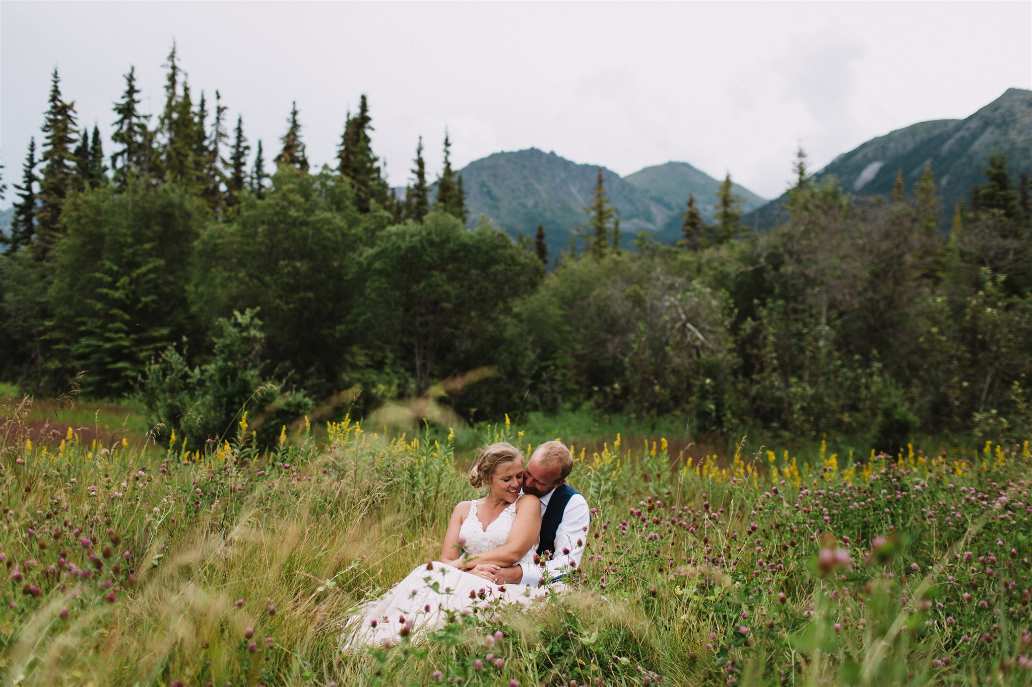Bride and groom amongst the wild flowers