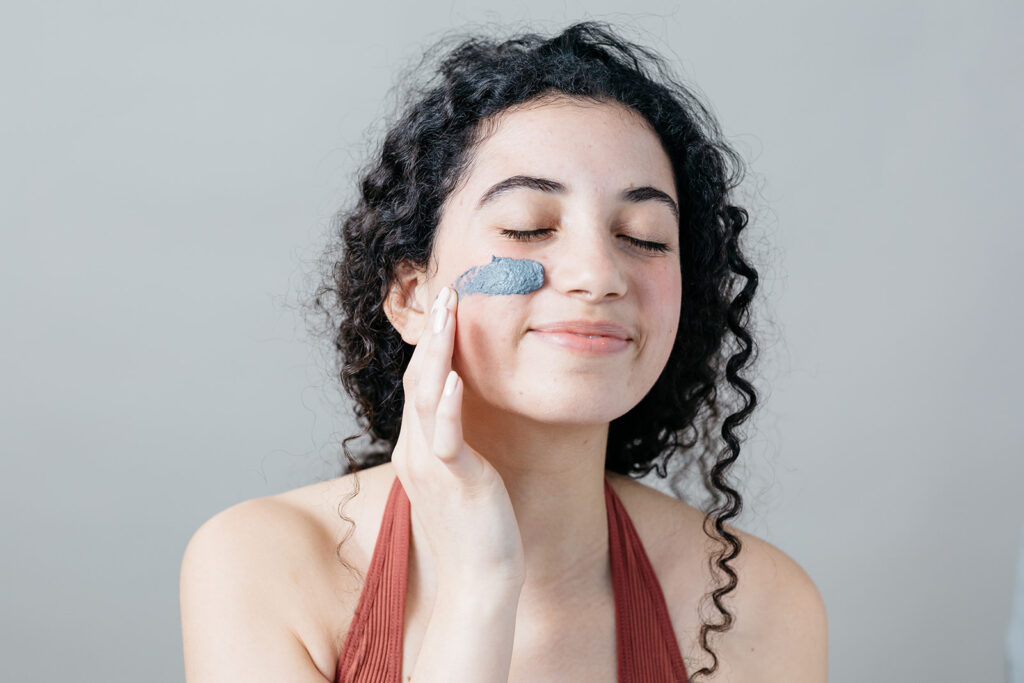 Skincare product on lady's face during photoshoot in Montreal.