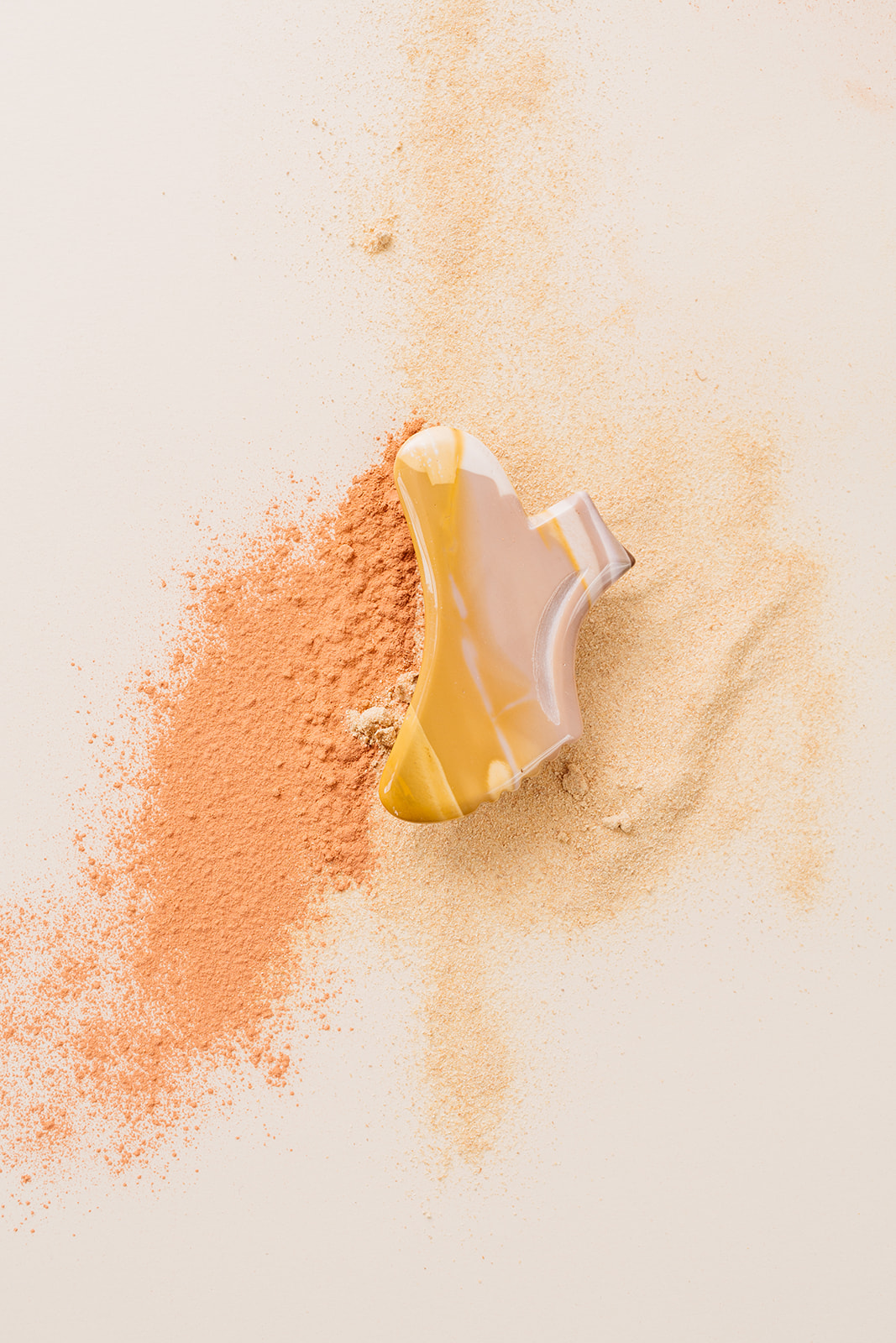 Skin care product with two tone beige background. Product photography taken in Montreal.