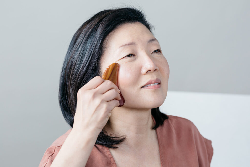 Woman photographed using a beauty product in Montreal.